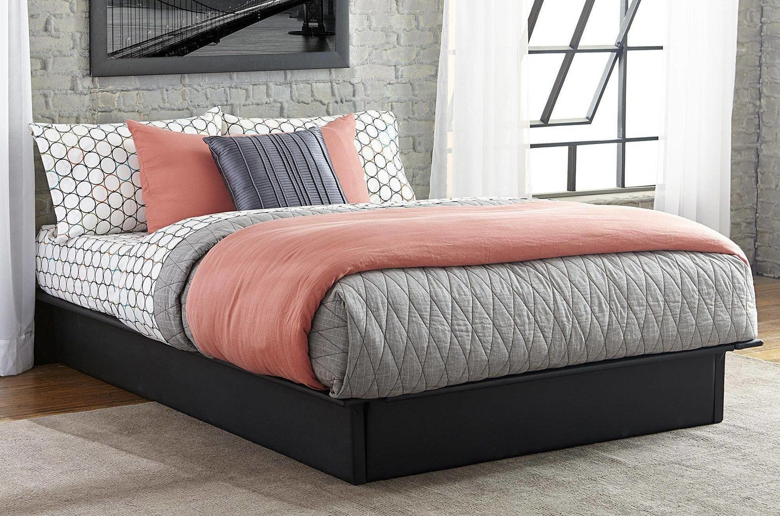 """Promising review: """"Love this platform bed. It's affordable, looks nice and is perfect for a first apartment. I was concerned about my mattress sliding around on it, but it stays in place."""" —NFJFPrice: $119+ (available in sizes twin-queen and two colors)"""
