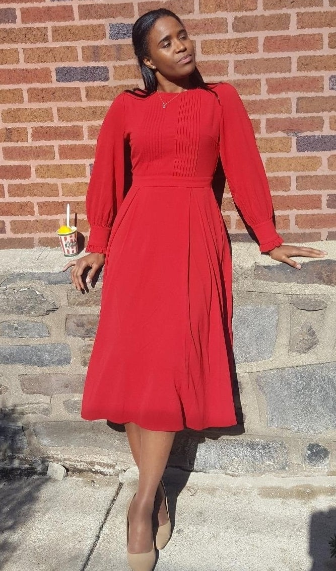 """Reviewers mention that this dress runs small, so size up when purchasing!Promising review: """"This red dress is thick, yet has a beautiful drape to it. The sleeves are lantern-shaped and have a cute ruffled detail on the edge. The pin tucks in the front and back are placed in the perfect spot to accentuate the waist. The dress fits like a glove."""" —Ruth MaldonadoGet it from Amazon for $31.99+ (available in sizes XS–XL and nine colors)."""