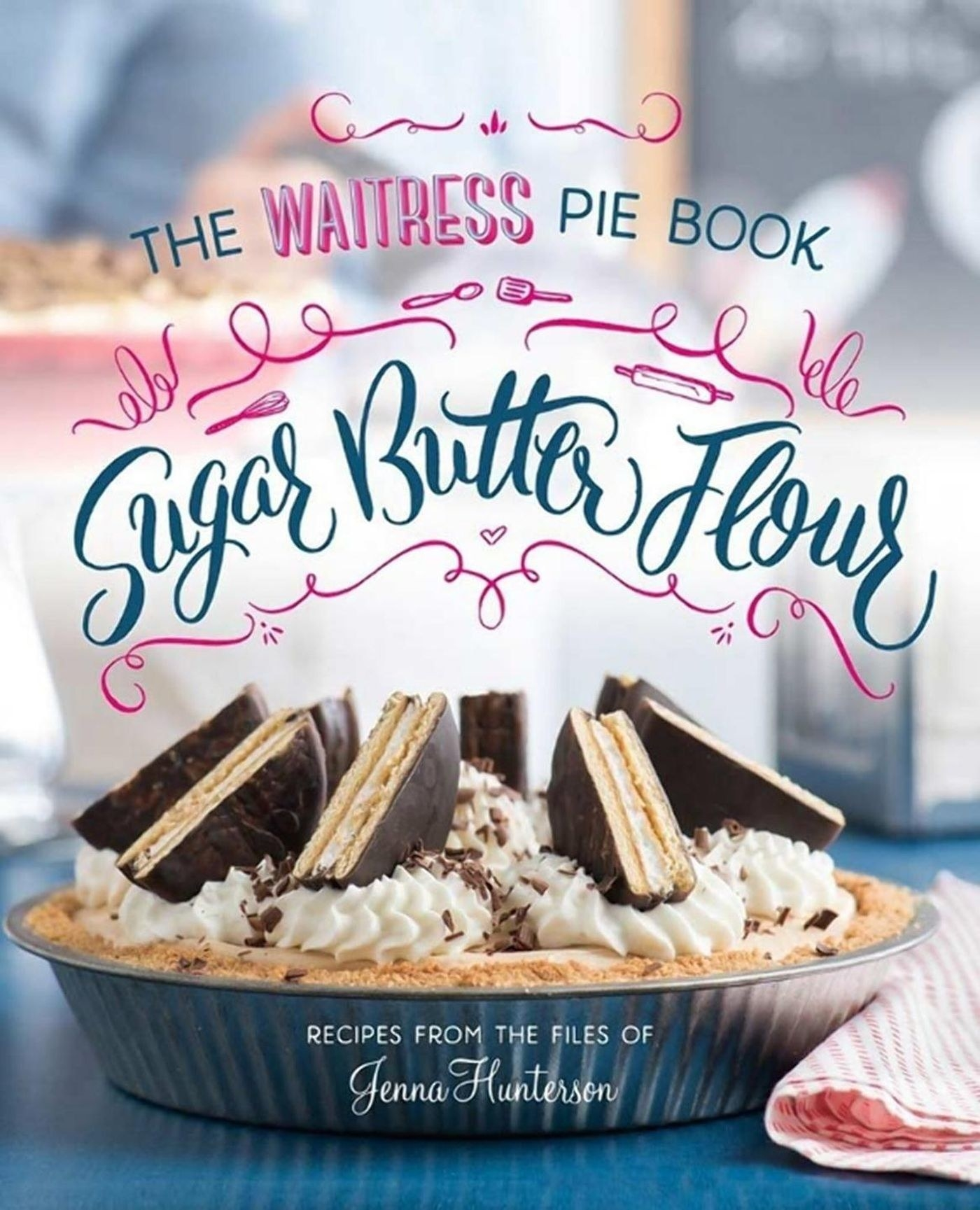 The cover of the book with a beautiful pie on it