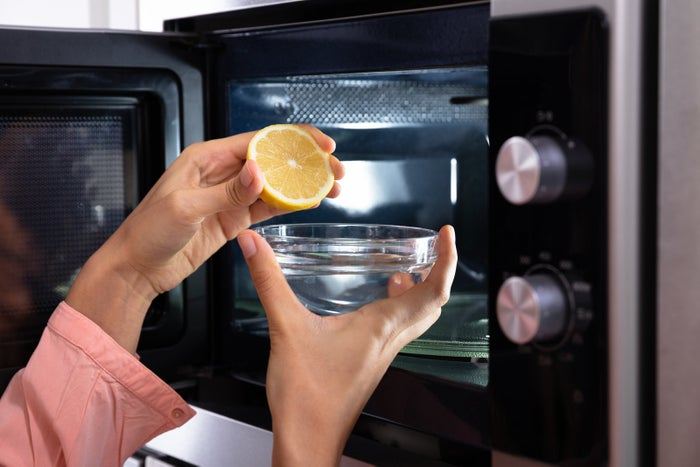 Fill a measuring cup or microwave-safe bowl with water, slice a lemon in half, and squeeze the lemon juice into the water. Microwave the bowl for about three minutes. The steam combined with the lemon juice will leave your microwave smelling fresh and delicious.