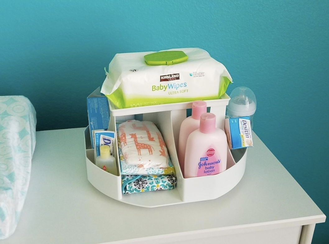 """Promising review: """"This was wonderful for my first baby! It spins with ease. I always kept it stocked and organized on the changing table. The fact that it spins like a lazy Susan makes it easier to grab what you need with one hand. Came in handy during those late night feedings/changings! A standard wipes case fits perfectly on top, and the diaper slots can even hold pull-ups. We are still using this and my daughter is two now. I'm buying another one for our second baby on the way!"""" —Erica BooneGet it from Amazon for $28.95."""