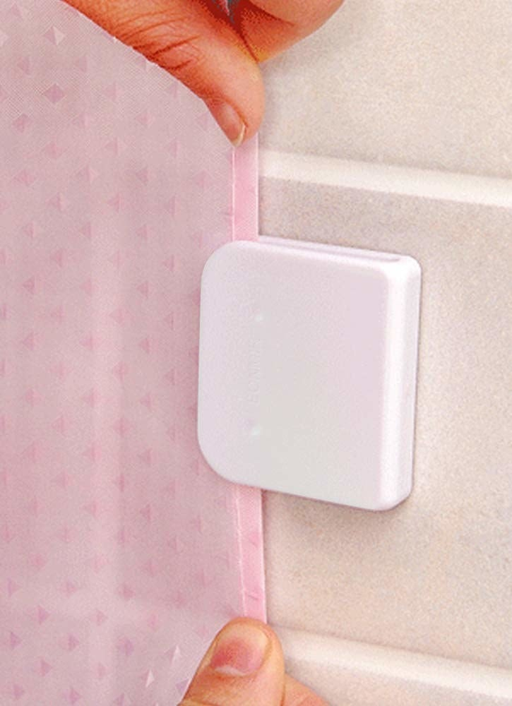wall clip that hangs onto shower curtain