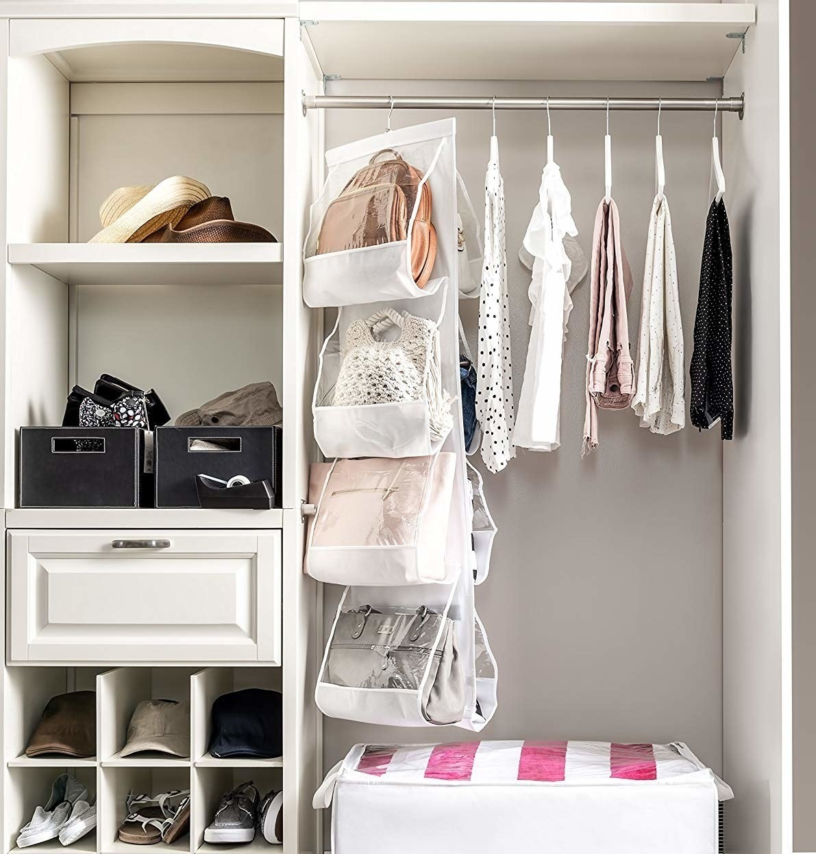 hanging purse organizer hung in closet with different purses inside each pocket
