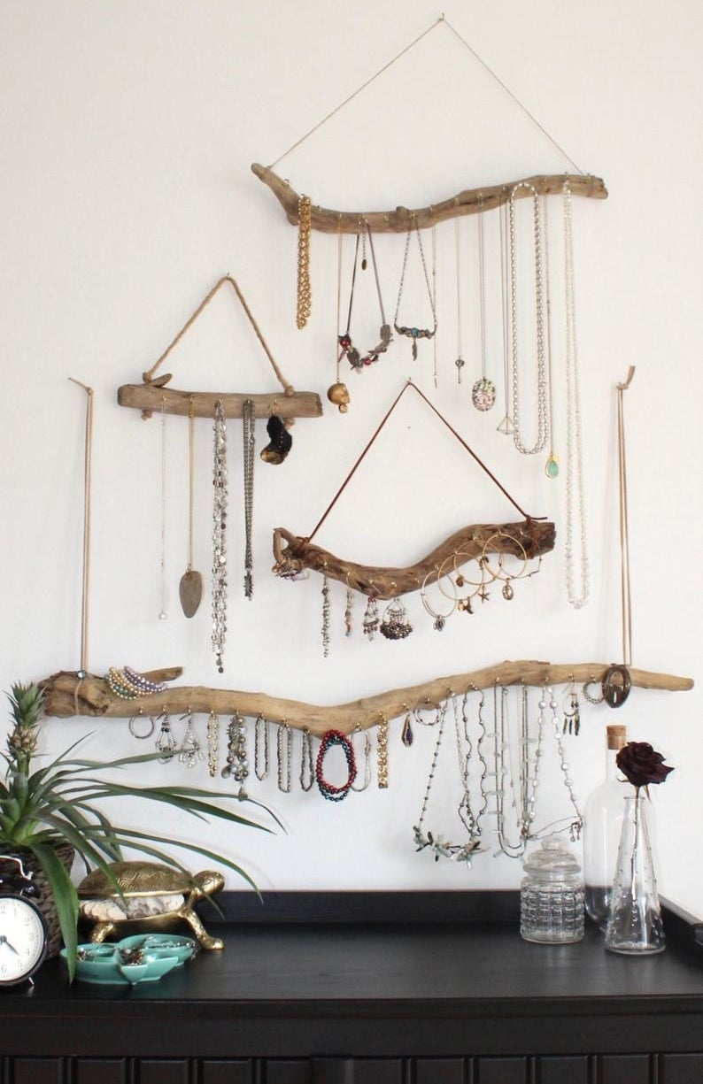 different styles of the wood jewelry organizer hung on a wall