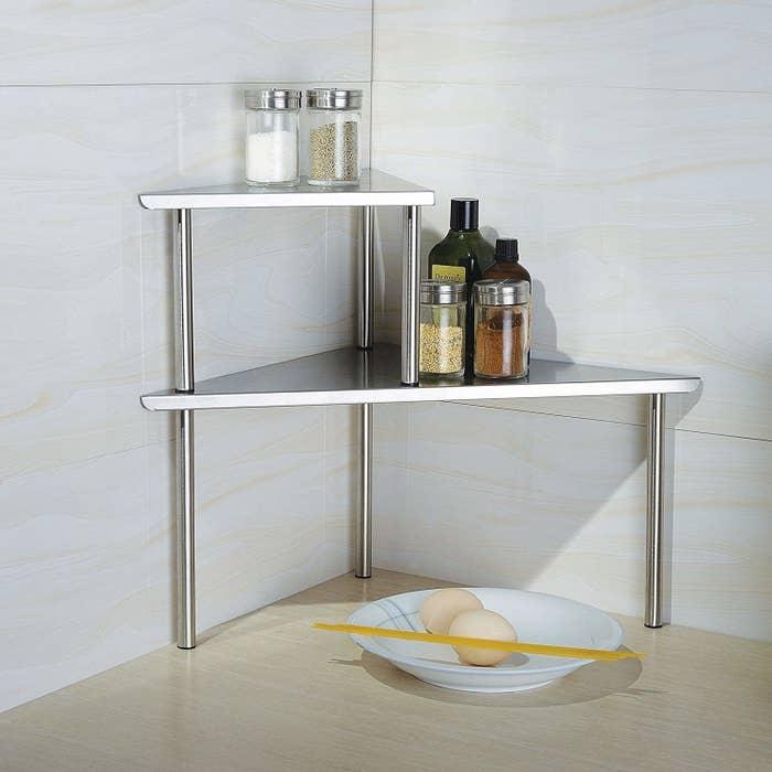 Two-tier storage shelf in corner of kitchen