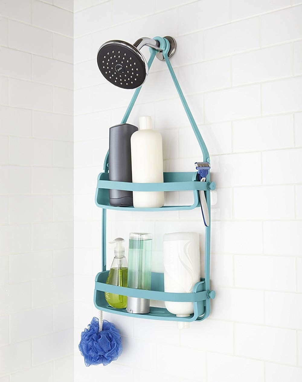 the surf colored flex shower caddy hanging in a shower with toiletries on the shelves