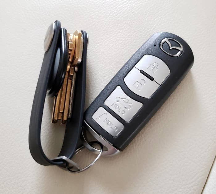 Reviewer image of rubber key holder attached to a key fob with four keys neatly tucked away inside of it
