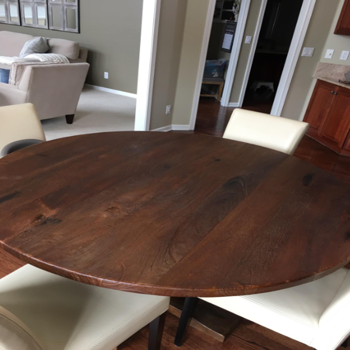 The same wood table looking hydrated, smooth, and brand new after using the wood wax