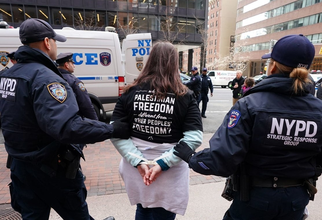Demonstrators are arrested in front of Sen. Chuck Schumer's office in New York, 2018.