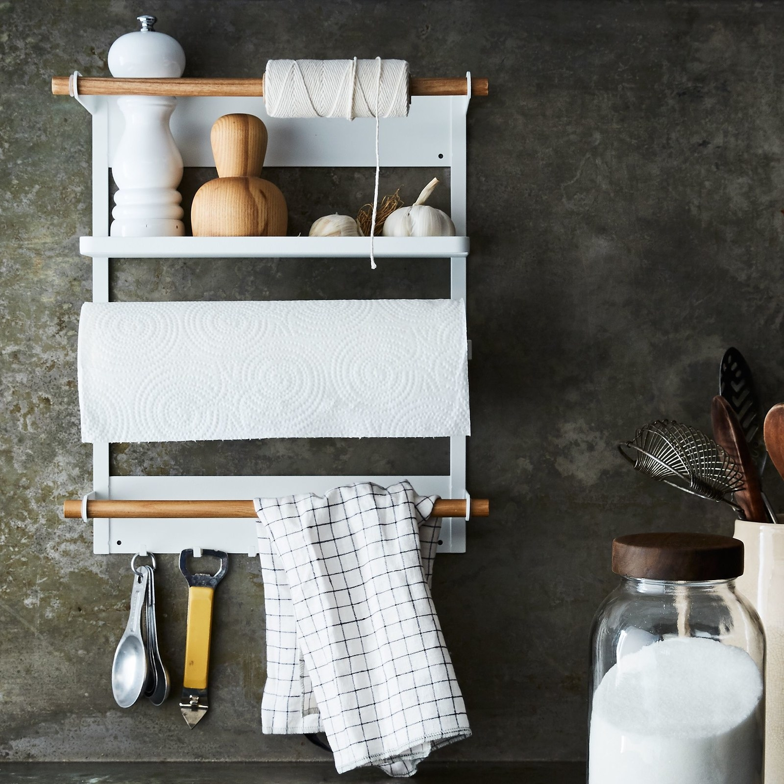 close up of the steel and wood magnetic fridge rack hanging in a kitchen