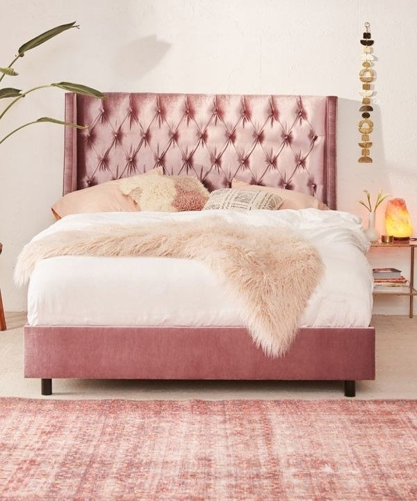 """Sold as just the bed frame and headboard. Mattress and pillows are sold separately!Promising review: """"Oh my gosh! This bed is amazing! It is so luxurious and I have received soo many compliments! Looks just like the picture!"""" —faithls85Get it from Urban Outfitters for $1,299+ (available in sizes full–king and five colors)."""