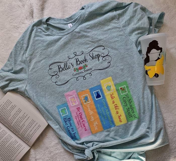 7dfc00895 Or a Belle's Book Shop shirt, a must-have for any bookworm who grew up  idolizing the character who wanted