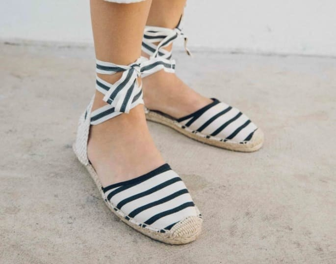 model wearing espadrilles in a black and white stripe print