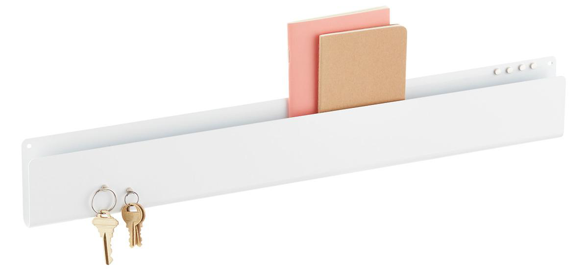 Magnetic wall pocket strip with keys hanging and notebooks in slot
