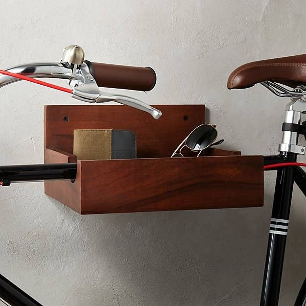 Get it from CB2 for $49.95.Or, why not try our tutorial for DIY-ing your own wooden bike rack?