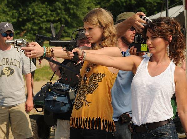Shooting a gun with shania twain
