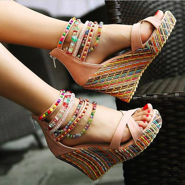 model wearing wedges with colorful wedges and beaded straps