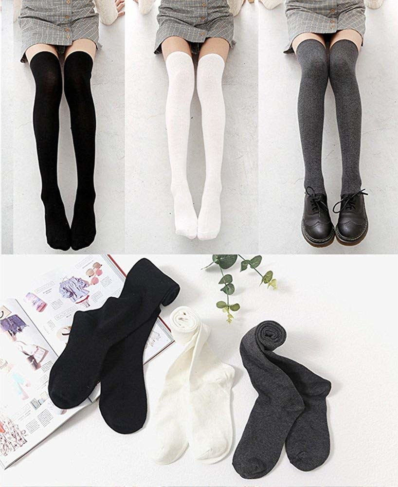 three pairs of long socks in black, white, and grey