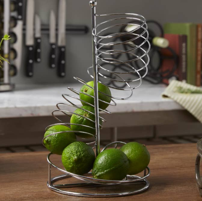 An upright spiral fruit basket in stainless steel