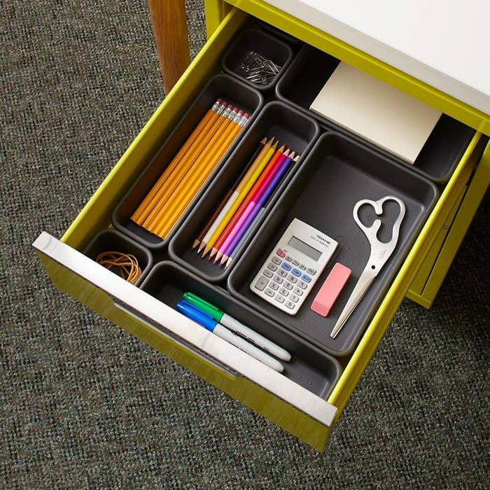 """The junk drawer is probably the most opened drawer in your home, so why not make it less of a headache? There are eight total and they're completely modular, so you can arrange them in any way you want.Promising review: """"These things are AWESOME!! I love the fact that you can lay them out however you want and still connect them. They are perfect for the so-called junk drawer — you can give all the odd stuff a home and have it organized. When my hubby asks for a pen, I tell him to open the junk drawer and they are on the far right in the long bin. He actually could find them easily without digging, it was great!"""" —Shelley RGet a pack of eight from Amazon for $12.50 (also available to purchase in multipacks).If organizing speaks to your soul, check out the best home organization products on Amazon."""