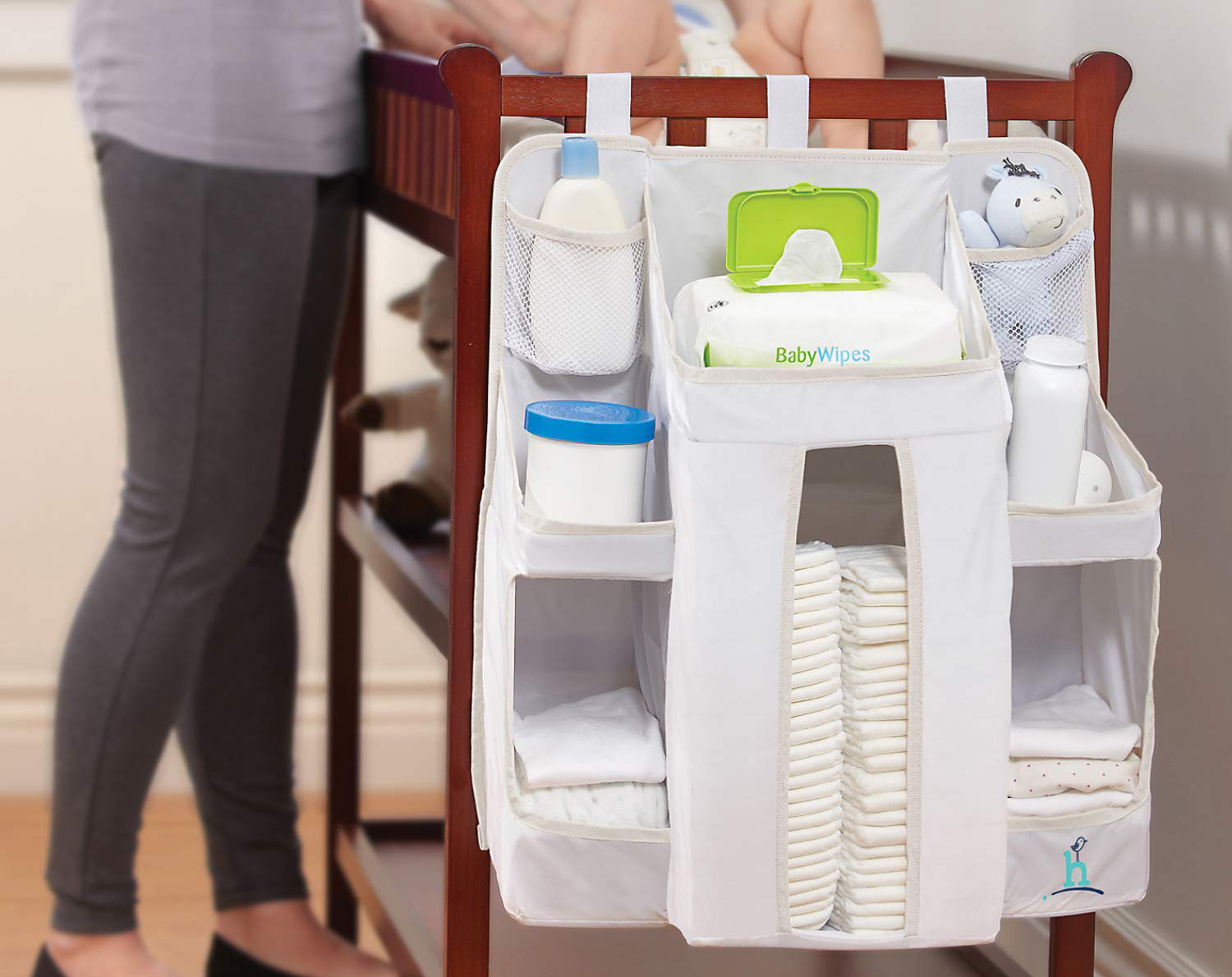 Nursery organizer and diaper caddy attached to crib