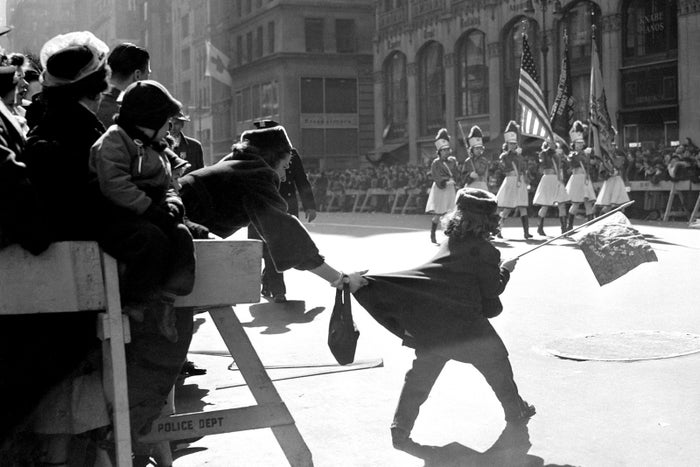 A girls tries to join the parade in 1950.
