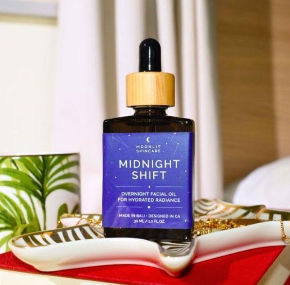 a dropper bottle of moonlit skincare midnight shift