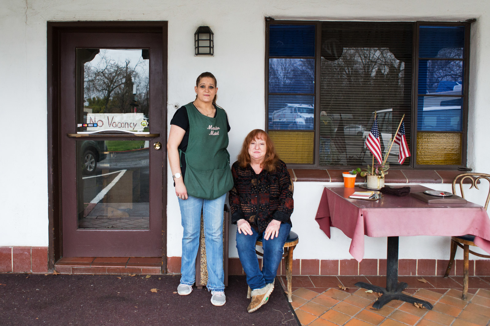 Irene White, owner of the Matador Motel, and Krista Clatterbuck, an employee of the motel, outside the front entrance of the motel in Chico, California.