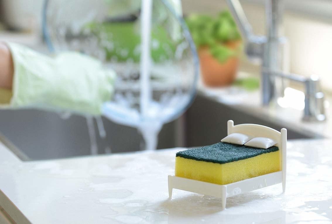 Small plastic bed frame holding kitchen sponge