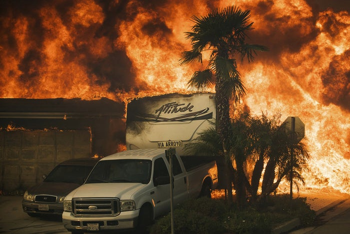 Flames consume a home on Via Arroyo as a wildfire rages in Ventura, California, on Dec. 5, 2017.