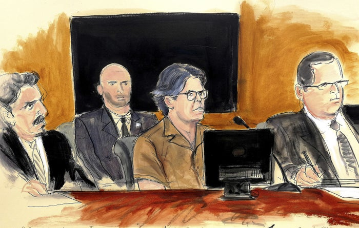 In this courtroom sketch, Keith Raniere, second from right, attends a court hearing on April 13 in New York.
