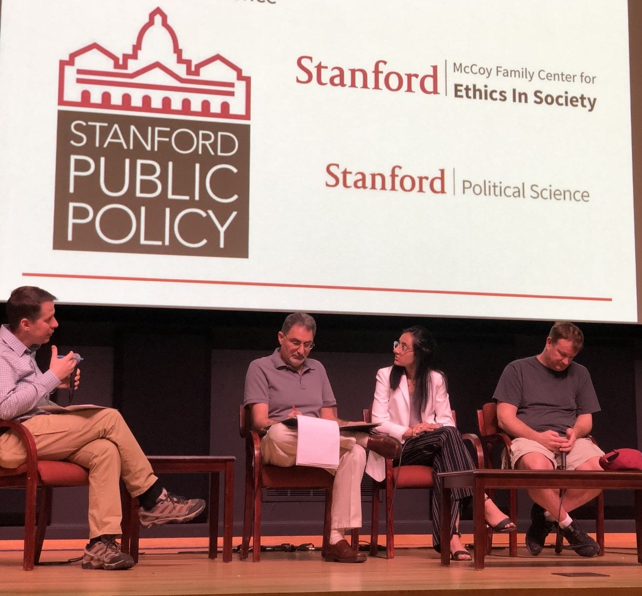 WhatsApp cofounder Brian Acton, right, spoke at Stanford University on March 13, 2019.