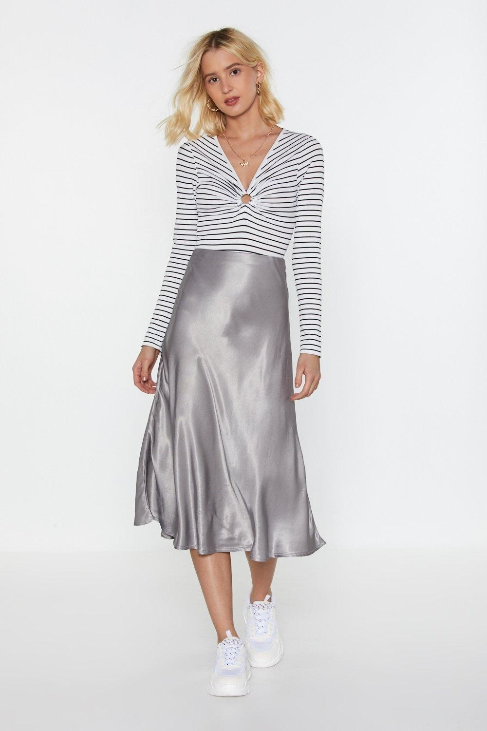 99662f0c14 A satin skirt that ll help you make a  smooth  transition from wearing  jeans all the time. Dare I say when you start wearing this with sneakers  and band ...
