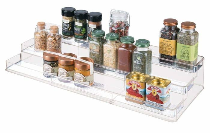 """Promising review: """"I love this expandable shelf system! Made my messy pantry so much more organized! It doesn't fit large cans but my other spices and pantry items fit! The plastic is heavy and I love that each shelf has a """"front"""" so nothing slides off."""" —Amazon CustomerGet it from Amazon for $19.99 (available in four colors)."""
