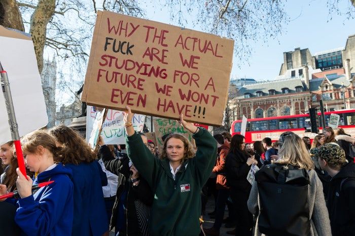 Young people protest in Parliament Square in central London.