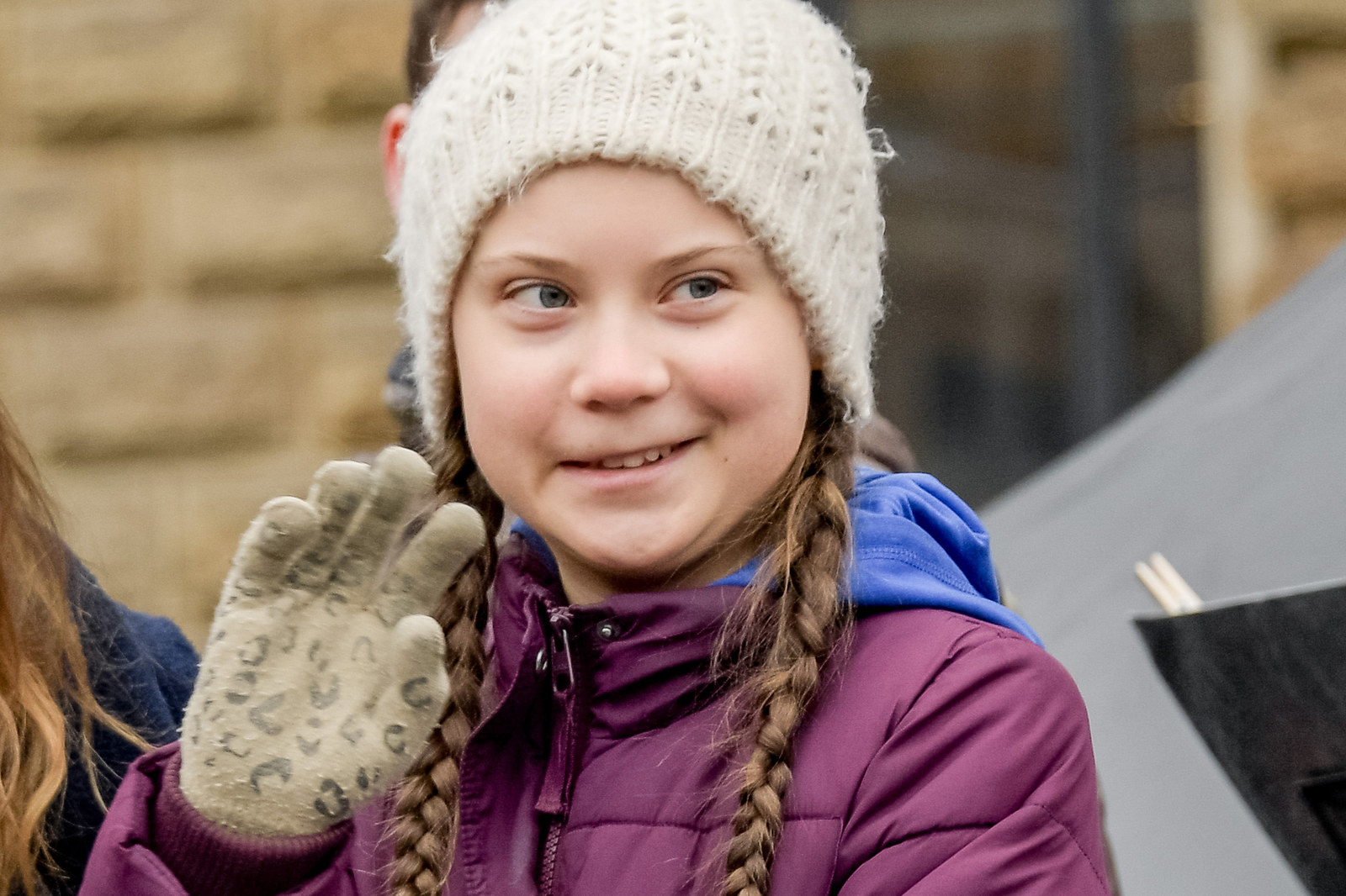 Swedish climate activist Greta Thunberg waves on stage during a demonstration of students in Hambourg, Germany.