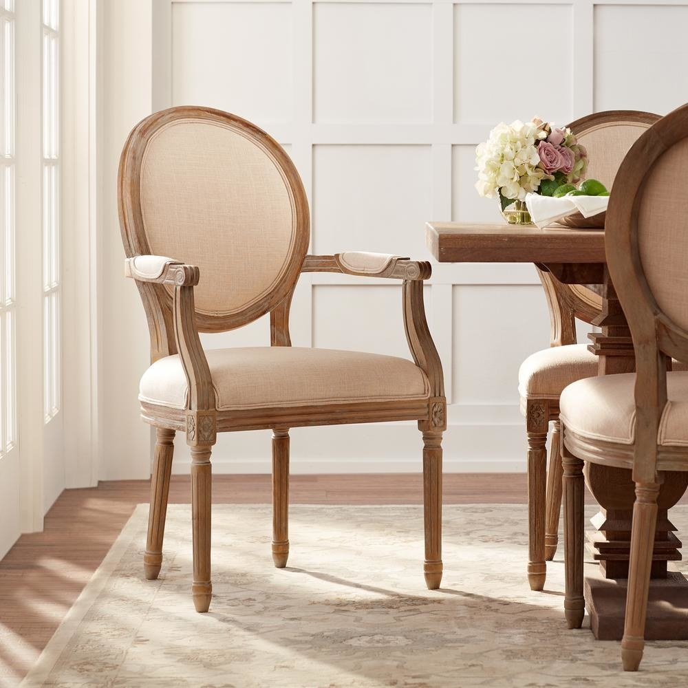 """Promising review: """"Love this chair. It sits perfectly at the head of the table! My husband was worried about the width of the seat; some dining chairs with arms are narrow, but this has plenty of room and is very comfortable. A great buy and a beautiful addition to my dining table."""" —TheresaPrice: $235.60+ (originally $294.50, available in two colors)"""