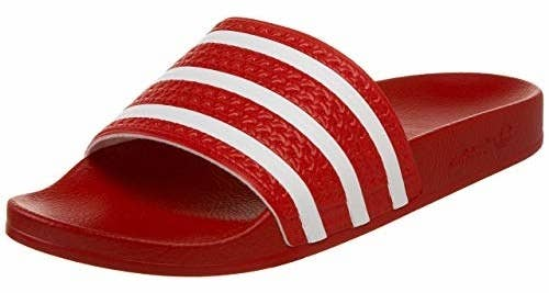 """Promising review: """"These are my fourth pair. And for good reason. Classic Adidas soccer flip-flop with a punch of summer color. They are great for the beach, boat, walking around town or going to class. I wear them with or without socks and there is nothing bad to say about them. Been wearing them for 20 years. I had one pair that lasted 13 years and I forgot them in Puerto Vallarta 🙃"""" —Amazon CustomerGet them from Amazon for $24.99+ (12 colors combos, men's sizes 3–15). AND these are available through Prime Wardrobe so you can try on options if you have the service."""