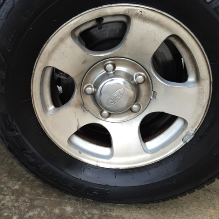 same reviewer showing hubcap looking brand new and clean