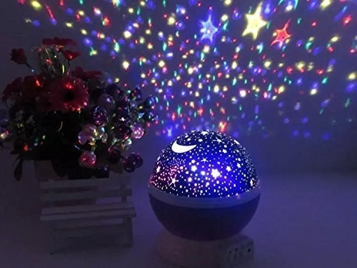 the star light projecting star shapes into a bedroom