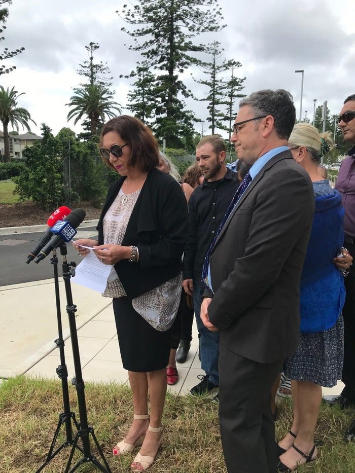 Naomi Williams' cousin Anita Heiss reading a statement on behalf of Williams' mother Sharon. The stands with other family members, Williams' partner Mick Lampe and lawyer George Newhouse.
