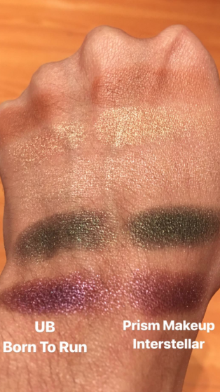 Reviewer swatching the Interstellar palette and comparing it to the Urban Decay Born to Run palette. The colors are very similar.