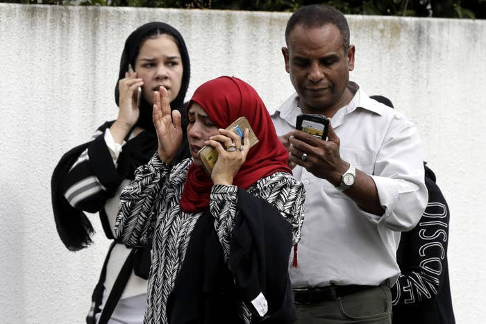 People wait outside the Al Noor mosque in Christchurch, New Zealand, on March 15, following a horrific mass shooting.