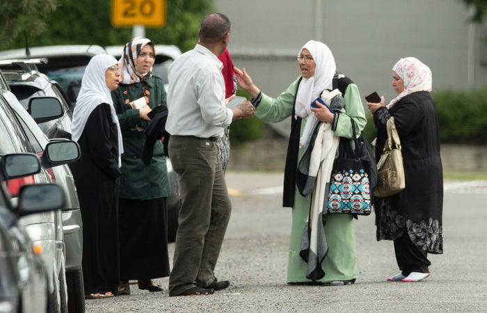 Members of a family react outside the mosque following a shooting at the Al Noor mosque in Christchurch, New Zealand.