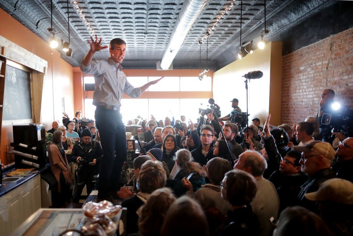 Beto O'Rourke stands on a countertop at Central Park Coffee Company March 15, 2019, in Mount Pleasant, Iowa.