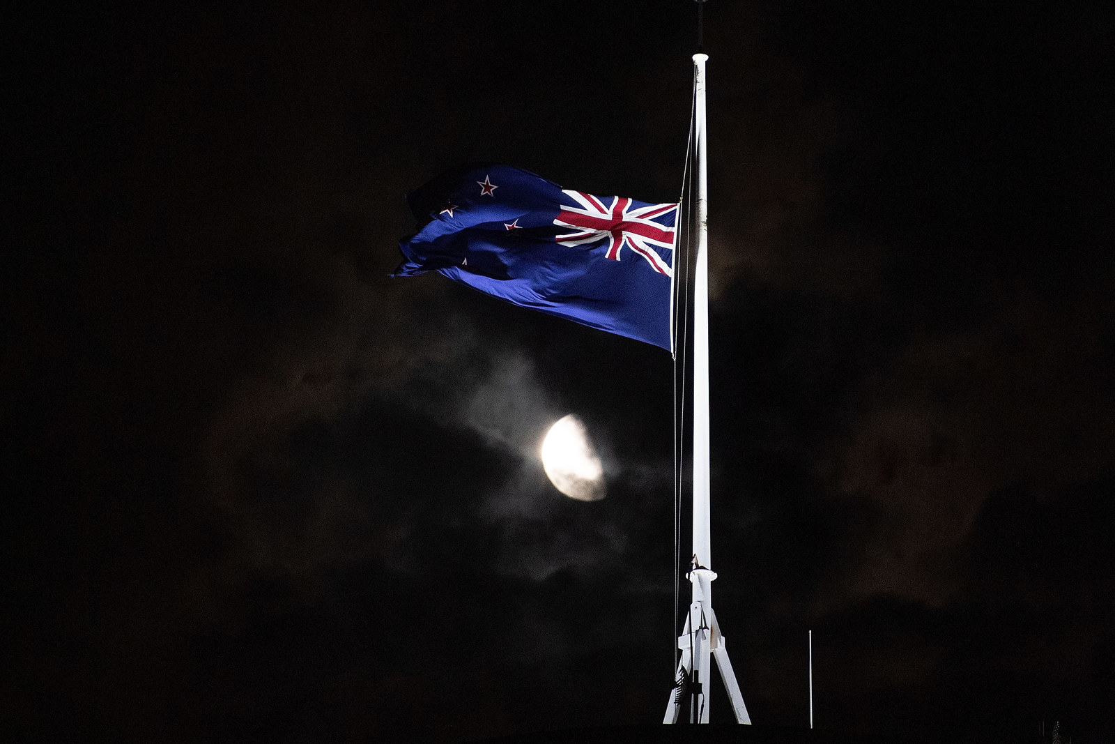 The New Zealand national flag is flown at half-mast on a Parliament building in Wellington.