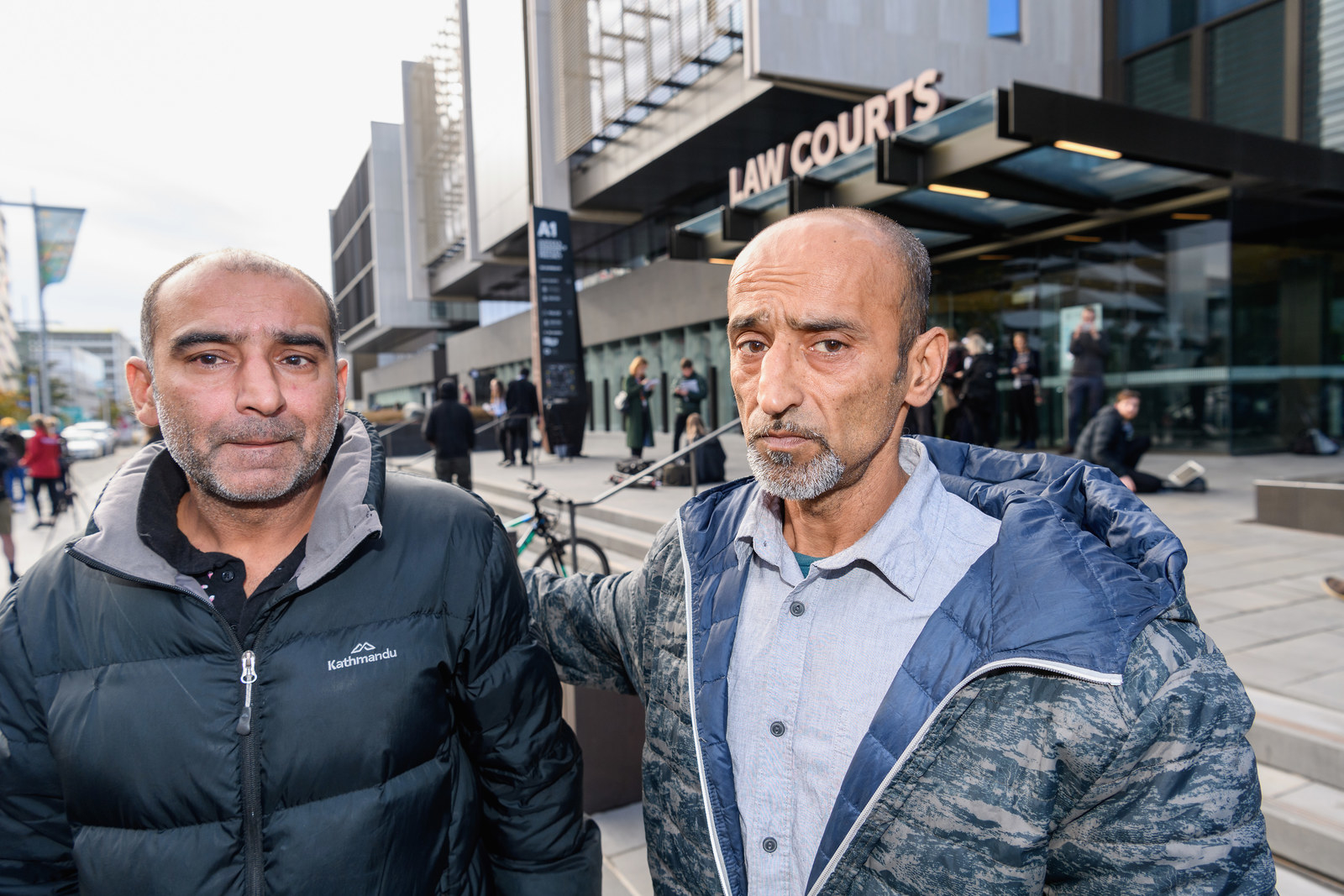 Brothers Yama Nabi and Omar Nabi (L-R) speak to the media about their father Daoud Nabi who was killed at Al Noor mosque as they wait in front of Christchurch District Court