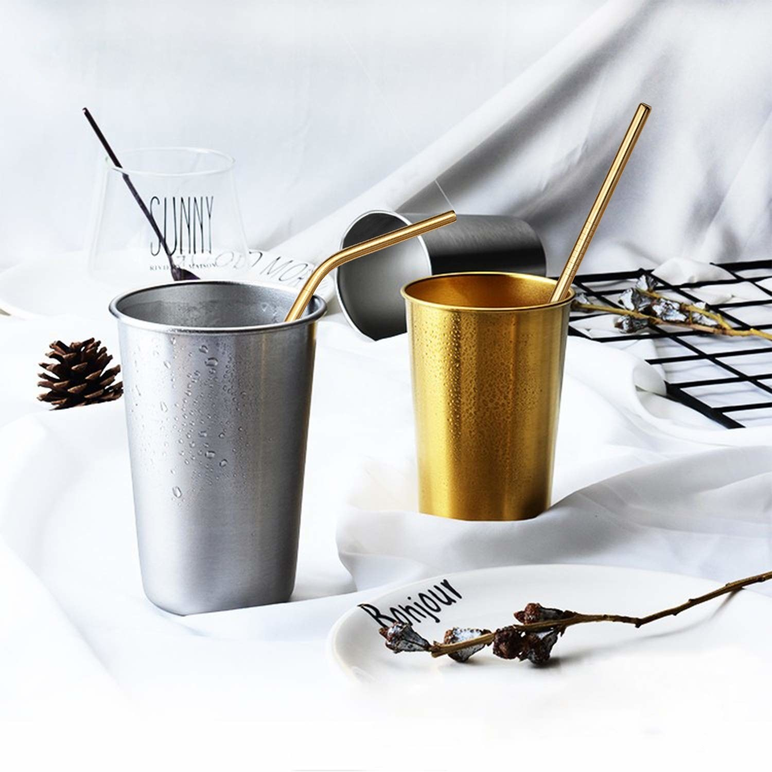 two cups with gold straws