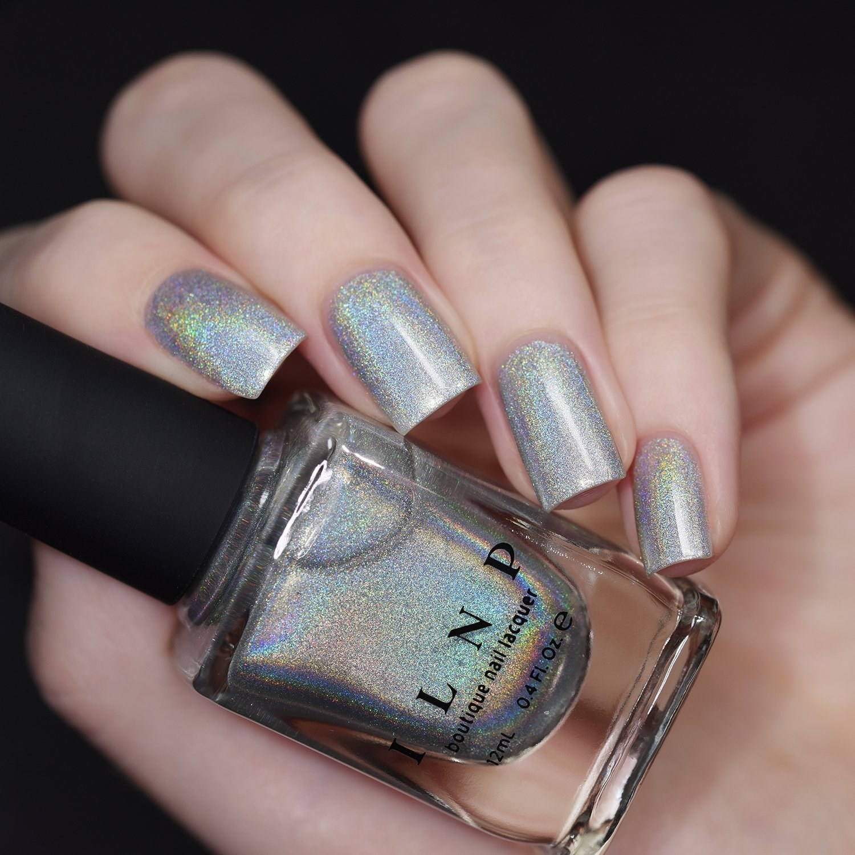 hand holds glittery nail polish