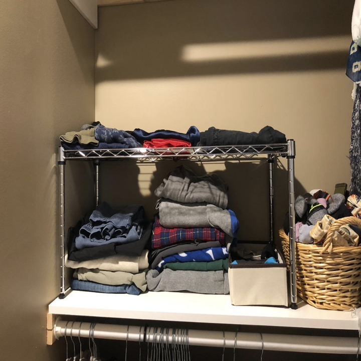 Reviewer photo of the shelf on the top of a closet making more room to store t-shirts
